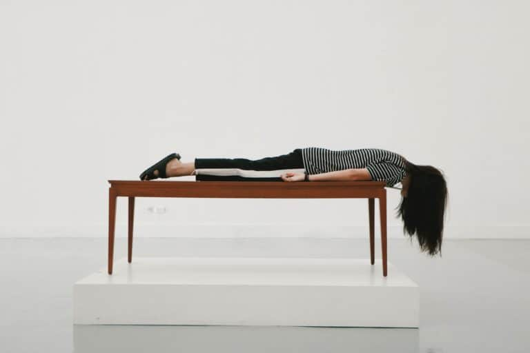 woman planked on a table